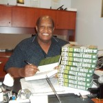 Willie Davis signing books